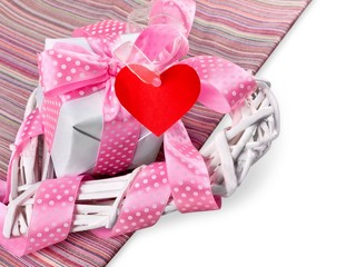 Present. Beautiful gift on pink and white background with sample