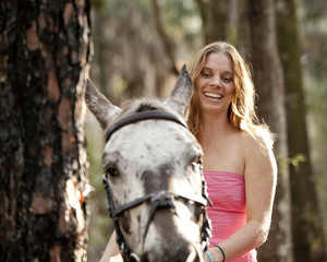woman on horseback in forest