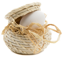Organic egg in basket close up