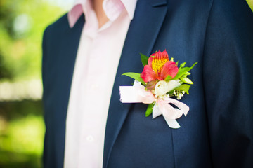 boutonniere flower on a groom