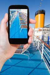 tourist photographs upper deck of cruise liner