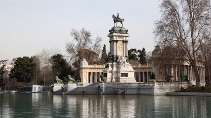 Equestrian monument to Alfonso XII reflected in pond