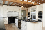 Luxury Fitted Kitchen In House With Beamed Ceiling - 80149315