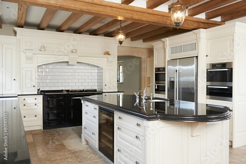 Luxury Fitted Kitchen In House With Beamed Ceiling poster