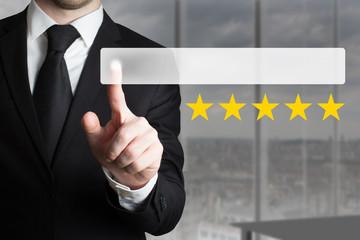businessman pushing button five golden stars