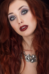 Vampire redhead woman with silver necklace