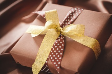 Gift. Two foil gifts with yellow,gold,brown bows