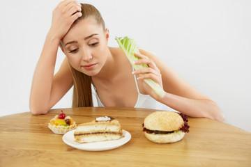 Diet concept.  Beautiful Young Woman eats Lettuce