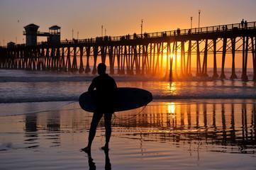 Surfer near the Oceanside Pier, Southern California, USA