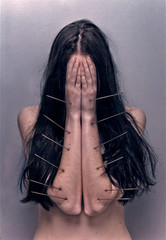 Young woman covering face with hand