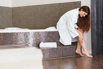 Beautiful Woman Cares About Legs After Bath. Long Woman Legs.