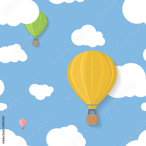 Three coloured aerostats in blue skies with clouds seamless
