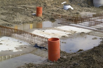 Pipes sticking out of the ground on a construction site