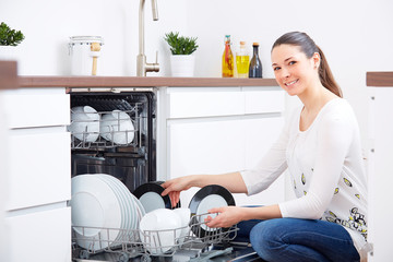 20s woman in kitchen, empty out the dishwasher 4