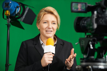 Female Journalist Presenting Report In Television Studio