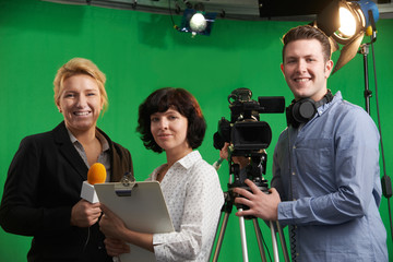 Portrait Of Cameraman With Presenter And Floor Manager In Televi