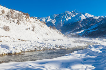 River in a mountain valley at winter