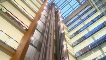 Multilevel building with glass roof and elevators
