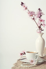 coffee and pink cherry blossoms