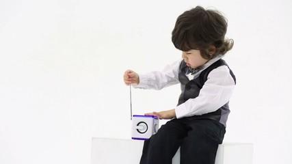 boy plays with wireless radio and pulls telescopic antenna