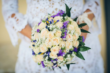 bridal bouquet with blue flowers and white rose