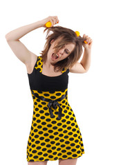Young woman in studio with yellow balls in hair isolated on whit