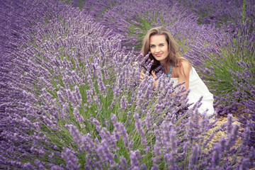 The joy of a beautiful young girl on the lavender field