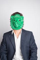 Business Monster Man using a green lion mask.