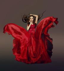 Woman in fluttering red dress