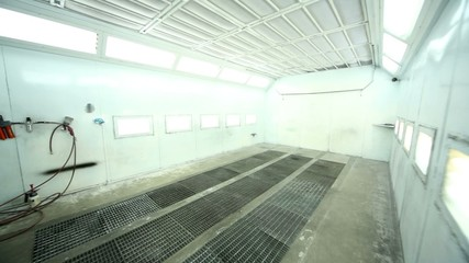 Entrance to paint-spraying booth with many lights for cars