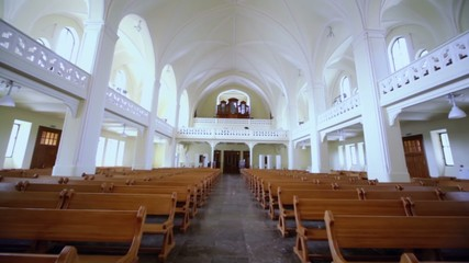 Rows of benches and organ in Evangelical Lutheran Cathedral