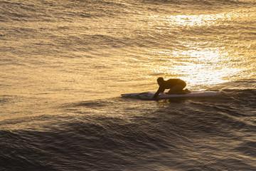 Athlete Paddling Rescue Craft Waves