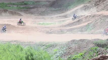 Several bikers ride buy ground tracks during motorbike race