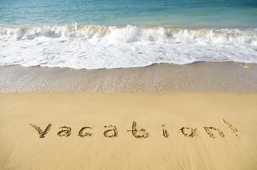inscription vacation on sea sand beach