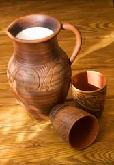 Clay jug with milk