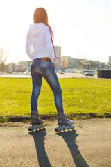 roller skates on beautiful girl's feet