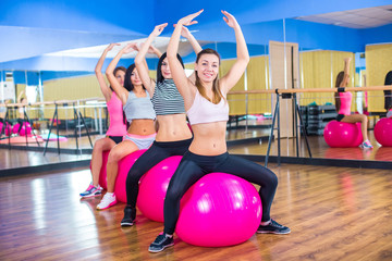 Fitness - Young women doing sports training or workout with gymn