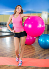 Portrait of fit and healthy gym woman with ball in fitness cente