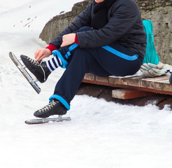 woman with ice skates on winter ice