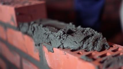 Brickwork process with trowel, closeup view