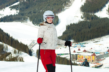 A female skier on the piste in moutain