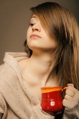 Beverage. Girl holding cup mug of hot drink tea or coffee