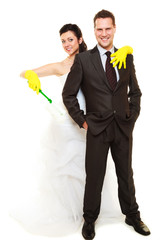 Just married holding cleaning supplies.