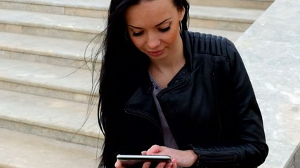 Closeup of young woman with tablet on the bench working