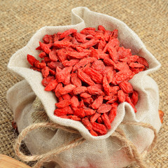 Dried goji berries (Lycium Barbarum - Wolfberry) in a burlap bag