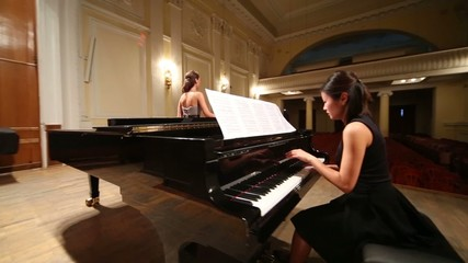 Back around review woman pianist playing piano and opera singer