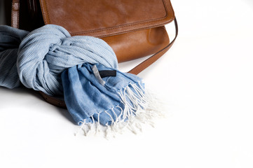 Woman leather bag with scarf closeup isolated on white. Light br