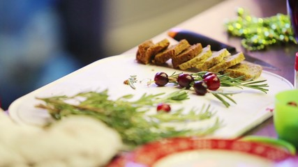 Female hands do decoration for meal using herbs and berries