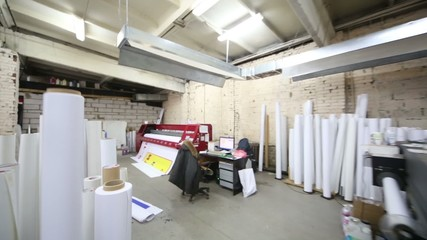 Room in printing house with large printer for format printing