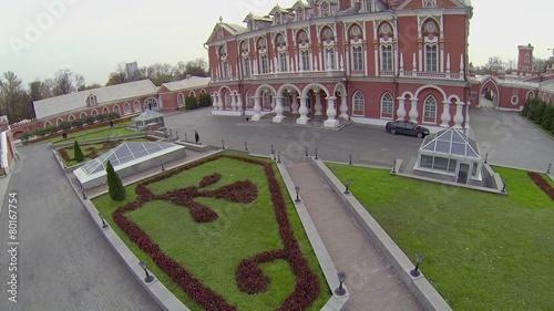 People walk near edifice of Petrovsky Travelling Palace t-shirt